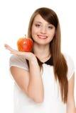 Diet. Girl offering apple seasonal fruit. Stock Photos