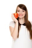 Diet. Girl offering apple seasonal fruit. Royalty Free Stock Photography