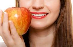 Diet. Girl offering apple seasonal fruit. Royalty Free Stock Images