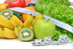 Diet weight loss breakfast concept with tape measure organic gre Royalty Free Stock Photos
