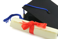 Diploma and graduation cap Royalty Free Stock Photo