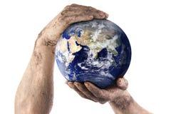 Dirty gardener hands holding world Royalty Free Stock Image