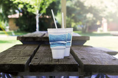 Disposable Cups On Picnic Table Royalty Free Stock Photography