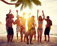Diverse People Dancing and Partying on a Tropical Beach Stock Images
