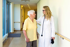 Doctor chatting to an elderly lady patient Stock Photography