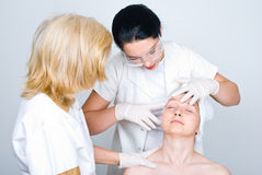 Doctor checking patient woman skin Stock Image