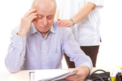 Doctor comforting mature stressed patient Royalty Free Stock Images