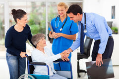 Doctor greeting patient Stock Photos