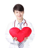 Doctor holding a red love heart pillow Stock Photos