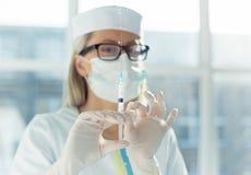 Doctor holding syringe Stock Photography