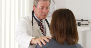 Doctor reassuring elderly patient of quick recovery Stock Photo
