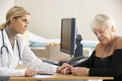 Doctor reassuring senior woman patient Royalty Free Stock Photo