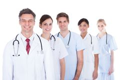 Doctors and nurses standing in a row Stock Photography