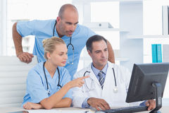 Doctors and surgeon working with computer Stock Photo