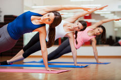 Doing a side plank for yoga class Stock Image