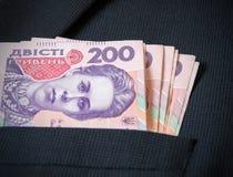 Dois cem hryvnia do ucraniano no revestimento dos seus homens do bolso Foto de Stock Royalty Free