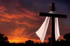 Dramatic Lighting on Christian Easter Morning Cross At Sunrise Stock Images