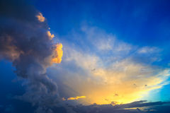 Dramatic sunset sky with yellow, blue and orange thunderstorm cl Royalty Free Stock Images