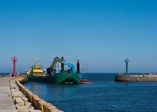 Dredger ship in port Stock Photos