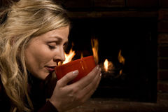 Drinking soup by the fire Stock Image