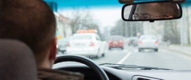 Driver eyes car driving steering wheel city road inside Royalty Free Stock Image
