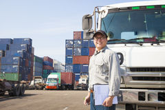 Driver in front of container truck Stock Photo
