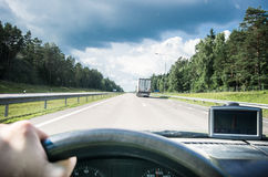 Driver in the road Stock Photography