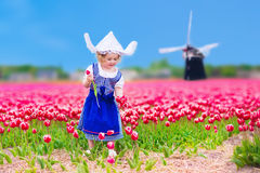 Dutch girl in tulip field in Holland Royalty Free Stock Photos