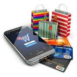 E-commerce. Online internet shopping. Mobile phone, shopping bag Royalty Free Stock Images