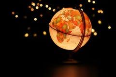 Earth globe glowing in dark starry sky Stock Photo