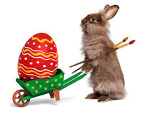 Funny Easter rabbit with a wheelbarrow and an East Stock Photos