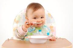 Eating baby girl Stock Photo