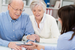 Elderly couple receiving financial advice Stock Images