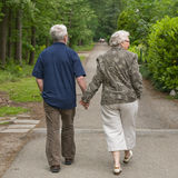Elderly couple walking hand in hand Royalty Free Stock Photography