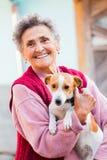 Elderly Lady with Pet Stock Photos