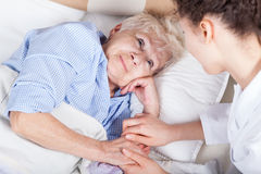 Elderly woman in bed Royalty Free Stock Image