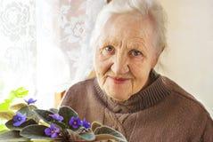 Elderly woman flower Stock Image