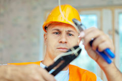 Electrician installing electricity Stock Photography
