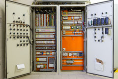 Electricity distribution box with wires, circuit breakers and fu Stock Photos
