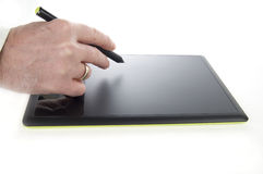 Electronic Graphic Tablet with Executive Hand and Pen Royalty Free Stock Photos