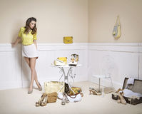 Elegant lady in a room full of fashion accessories Stock Images