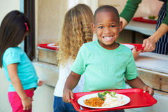 Elementary Pupils Collecting Healthy Lunch In Cafeteria Royalty Free Stock Photo