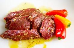 Elk steaks in marinade Stock Images