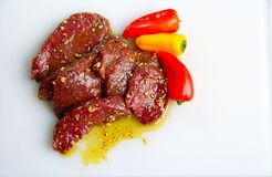 Elk steaks with peppers Stock Photography