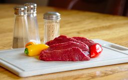 Elk  steaks, raw with peppers Stock Photo