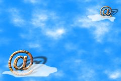 Email symbols over blue sky Royalty Free Stock Image