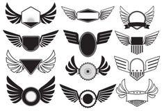 Emblemas com asas Imagens de Stock