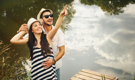 Embrace of happy romantic couple on pier explore the world of be Royalty Free Stock Photography