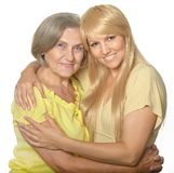 Embracing mom and daughter Royalty Free Stock Photo
