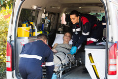 Emergency medical staff transporting patient Stock Photos